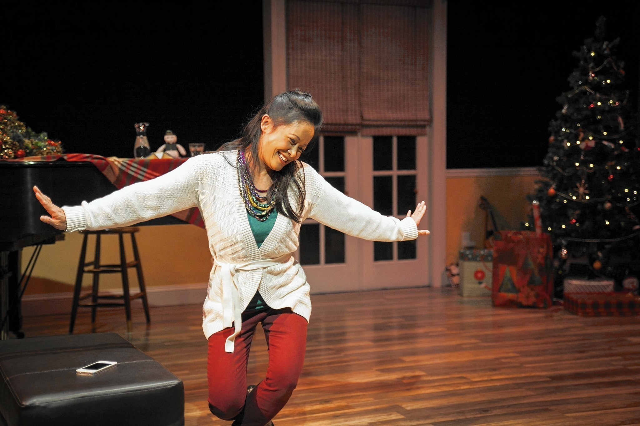 "Christine Bunuan in ""Christmas at Christine's"" at Silk Road Rising. Photo by Crimson Cat Studios."